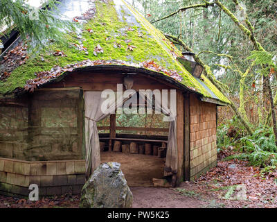 A beautiful little rustic hobbit house in a park in Washington state, USA - Stock Photo