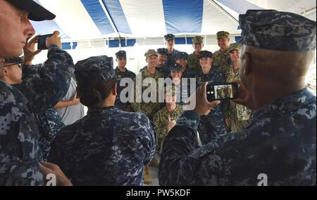KET WEST, Florida (September 21, 2017) Chief of Naval Operations Adm. John Richardson poses for a photo with Sailors at NAS Key West's Boca Chica Field during a tour and all hands call Sept. 21, 2017. The visit was to commend first responders for their quick and orderly relief efforts in the Florida Keys after Hurricane Irma's passing. NAS Key West is a state-of-the-art facility for air-to-air combat fighter aircraft of all military services and provides world-class pierside support to U.S. and foreign naval vessels. - Stock Photo
