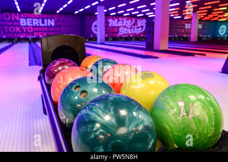 11 October 2018, Berlin: 11 October 2018, Germany, Berlin: View over colorful bowling balls into the Bowling World Berlin at Mercedes Platz. The square is located in the new city quarter along the East Side Gallery. The official opening is on 13 October. Photo: Jens Kalaene/dpa - Stock Photo