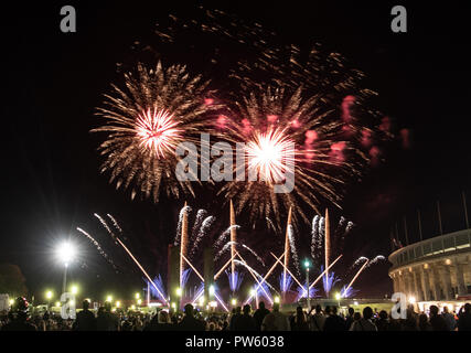 Berlin, Germany. 12 October 2018, Berlin: Numerous visitors following the opening of the 13th fireworks spectacle 'Pyronale' at the Olympic Stadium. Photo: Paul Zinken/dpa Credit: dpa picture alliance/Alamy Live News - Stock Photo