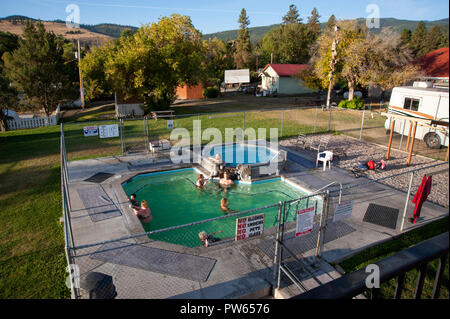 Mineral hot springs fill hot tubs at Symes Hotel resort in Hot Springs, Montana - Stock Photo