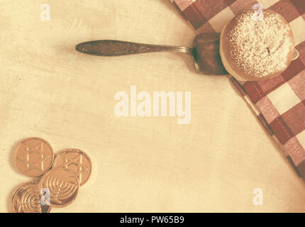 Flat Lay Jewish holiday hannukah symbols - donut and chockolate coins on vintage background,lot of copy space- Vintage Styled Image. - Stock Photo