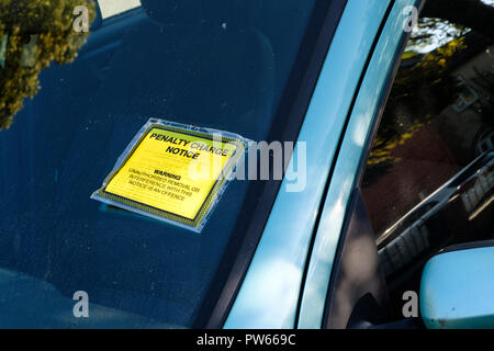 Parking fine. A Penalty Charge Notice stuck on a car windscreen, Lincoln, England, UK - Stock Photo