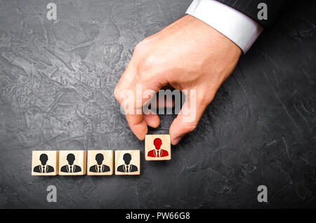 Headhunter recruits staff. The concept of finding people and workers on the job. Selection of teams, the appointment of a leader. Management of busine - Stock Photo