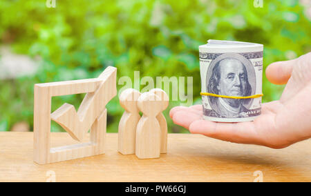 A hand is holding out money to people standing near the checkbox. Concept of voting and democratic elections. Corruption and bribery of voters. Voters - Stock Photo