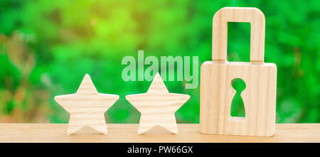 Three stars and a lock. The concept of high quality and protection. Consolidation of results and achievements. Recognition of quality. Effective prote - Stock Photo