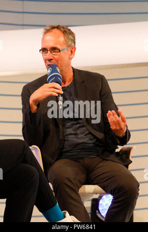 Frankfurt, Germany. 11th Oct, 2018. German author Volker Kutscher speaks at a talk at the Frankfurt Book Fair. The 70th Frankfurt Book Fair 2018 is the world largest book fair with over 7,000 exhibitors and over 250,000 expected visitors. It is open from the 10th to the 14th October with the last two days being open to the general public. Credit: Michael Debets/Pacific Press/Alamy Live News - Stock Photo