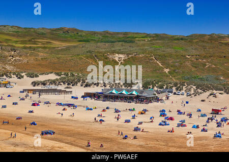 22 June 2018: Perranporth Beach, Cornwall, UK - Holidaymakers enjoying a warm summer day on the beach. - Stock Photo