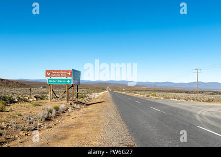 SUTHERLAND, SOUTH AFRICA, AUGUST 8, 2018: Turn-off from road R354 to the Tankwa Karoo National Park in the Northern Cape Province. Directional signs a - Stock Photo
