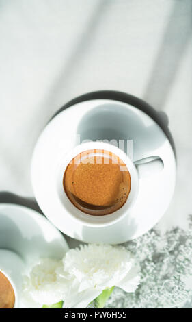 cup of espresso coffee and white flower - Stock Photo