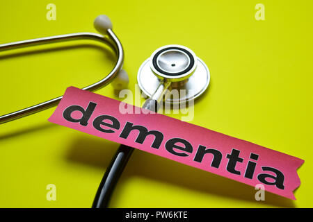 dementia with stethoscope concept inspiration on yellow background - Stock Photo