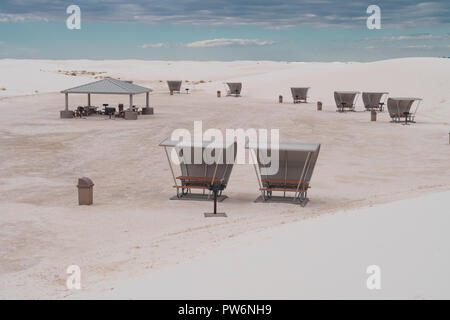 Area with retro style picnic tables rest area at White Sands National Monument in New Mexico - Stock Photo
