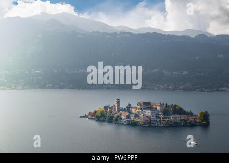 Lake Orta with San Giulio Island, aerial view. The island is part of the municipality of Orta San Giulio, province of Novara, in Piedmont, Italy - Stock Photo
