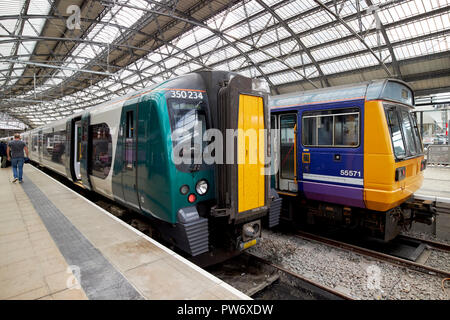 west midlands trains london northewestern railway train to birmingham and northern rail class 142 train Lime Street station Liverpool Merseyside Engla - Stock Photo