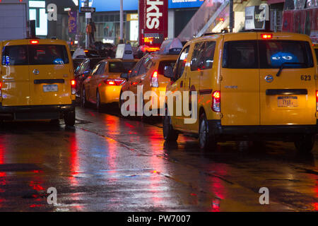 Yellow cabs in the rain, Time Square, New York, USA - Stock Photo
