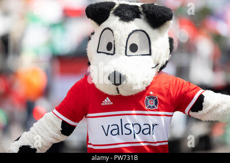 Chicago, Illinois , USA - September 9, 2018 The 26th Street Mexican Independence Parade, Sparky the Chicago Fire's mascot during the parade - Stock Photo