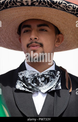 Chicago, Illinois , USA - September 9, 2018 The 26th Street Mexican Independence Parade, mexican man wearing traditional mariachi clothing - Stock Photo
