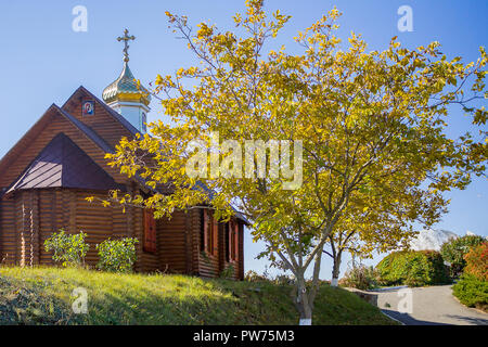 Small wooden rural church in autumn. No people - Stock Photo