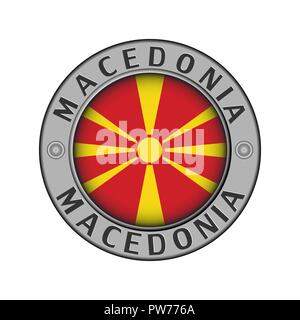 Round metal medallion with the name of the country of Macedonia and a round flag in the center - Stock Photo