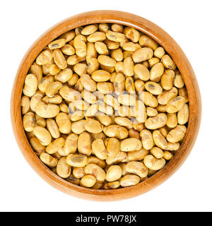 Roasted soybeans in wooden bowl. Dried, yellow soya beans, crispy roasted and slightly salted, used as snack. Rich in protein. Legume. - Stock Photo