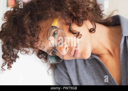 Brooding and thoughtful black woman face portrait - Stock Photo