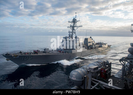181011-N-FC674-0029  PACIFIC OCEAN (Oct. 11, 2018)  The Arleigh Burke-class guided-missile destroyer USS Dewey (DDG 105) refuels at sea with the Nimitz-class aircraft carrier USS Carl Vinson (CVN 70). (U.S. Navy photo by Mass Communication Specialist 2nd Class Kurtis A. Hatcher/Released) - Stock Photo