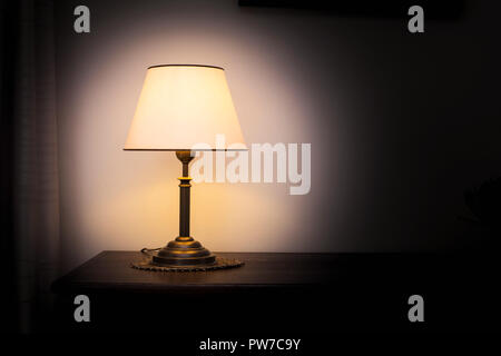 Lamp night light in a dark background. Vintage effect style picture. Minimal concept. - Stock Photo