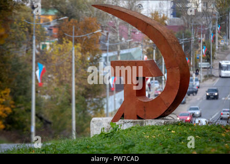 Stele 'Hammer and Sickle' installed on Moskovskaya Street in Pereslavl-Zalessky town of Yaroslavl Region, Russia - Stock Photo