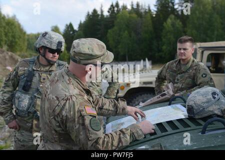 Lt. Col. Tadd Vanyo and Command Sgt. Maj. Shane Hybben, Command Team from 1st Combined Arms Battalion – 194th Armor visit with their Soldiers Sept. 21, 2017 who are participating along with the Swedish Armed Forces during the Aroura 17 exercise in Sweden. - Stock Photo