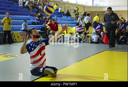 Army veteran Stefan Leroy, a former sergeant from Santa Rosa, Calif., practices serving drills during sitting volleyball preliminaries for the 2017 Invictus Games at the Pan Am Sports Centre in Toronto, Canada, Sept. 26, 2017. Leroy was injured when an improvised explosive device detonated June 7, 2012, causing him to lose both legs. - Stock Photo