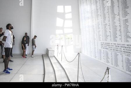 PEARL HARBOR (Sept. 27, 2017) DeAndre Jordan, basketball player for the Los Angeles Clippers reads over the names on the USS Arizona BB-39 Casualty List in the shrine room on the USS Arizona Memorial, Sept. 27. While on Oahu for their pre-season training camp, the entire LA Clippers basketball team, coaches, and staff took part in a tour of the USS Arizona Memorial. Along with the team, service members from all branches of the military met at Merry Point Landing, located on Joint Base Pearl Harbor-Hickam, to board a vessel which took them to the memorial. - Stock Photo