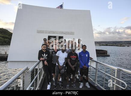 PEARL HARBOR (Sept. 27, 2017) Players from the Los Angeles Clippers basketball team take a group photo on the USS Arizona Memorial, Sept. 27.  While on Oahu for their pre-season training camp, the entire LA Clippers basketball team, coaches, and staff took part in a tour of the USS Arizona Memorial. Along with the team, service members from all branches of the military met at Merry Point Landing, located on Joint Base Pearl Harbor-Hickam, to board a vessel which took them to the memorial. - Stock Photo