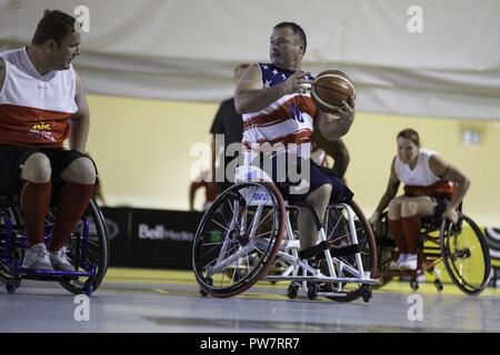 U.S. Army veteran Sean Hook attends the Wheelchair Basketball event during the Invictus Games at the Air Canada Centre (ACC), Toronto, Canada, Sept. 28, 2017. Invictus Games, September 23-30, is an international Paralympic-style, multi-sport event, created by Prince Harry of Wales, in which wounded, injured or sick armed services personnel and their associated veterans take part in sports including wheelchair basketball, wheelchair rugby, sitting vollyball, archery, cycling, wheelchair tennis, powerlifting, golf, swimming, and indoor rowing. - Stock Photo
