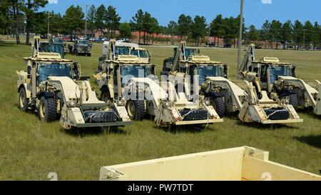 U.S. Soldiers assigned to the 178th Engineer Battalion, South Carolina Army National Guard, stage heavy equipment for transport to Puerto Rico at McEntire Joint National Guard Base. S.C. Sept. 29, 2017.  Engineers from South Carolina are being sent to help Puerto Rico with recovery efforts after Hurricane Maria devastated the island. - Stock Photo