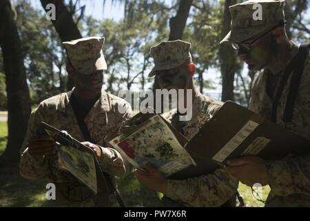 U.S. Marine Corps Recruits with Delta Company, 1st Battalion, Recruit Training Regiment, record their plot points at Elliot's Beach on Marine Corps Recruit Depot, Parris Island, S.C., Sept. 25, 2017.  The Land Navigation Course teaches recruits how to properly navigate unfamiliar terrain. - Stock Photo