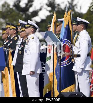 PYEONGTAEK, Republic of Korea (Sept. 28, 2017) Republic of Korea (ROK) Rear Adm. Brad Cooper, commander, Naval Forces Korea (CNFK) and Master Chief Chris Stone, CNFK command master chief, stand during the 69th annual ROK Armed Forces Day Ceremony. Armed Forces Day comemmorates the service of men and women in the ROK armed forces, the day that South Korea broke through the 38th parallel during the Korean War in 1950. Cooper is also presented the Presidential Unit Citation by ROK President Moon, Jae-in, this is the first time a U.S. Navy command is presented this award since the end of the Korea - Stock Photo