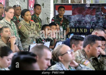 CIBENDA, Indonesia - Soldiers with the Tentara Nasional Indonesia Army (TNI-AD) and Hawaii Army Natinional Guard Soldiers participate in classes as part of Garuda Shield 2017 exercise, September 19, 2017 - Stock Photo