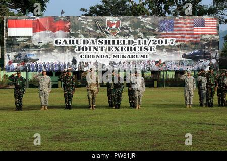 CIBENDA, Indonesia - Soldiers with the Tentara Nasional Indonesia Army (TNI-AD) and U.S. Army stood side-by-side on a parade field during the closing ceremony that officially marked the end of the Garuda Shield 2017 exercise, September 29, 2017 - Stock Photo