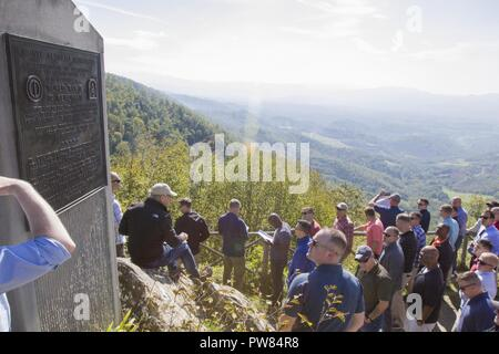 A group of 10th Combat Aviation Brigade, 10th Mountain Division (LI), Soldiers stops at a monument for Monte Altuzzo during a staff ride in Italy on September 30. The group was on a tour that retraced the history of their Division by visiting WWII battlefields and signifcant sites to gain a deeper understanding, appreciation, and connection to the Division. - Stock Photo