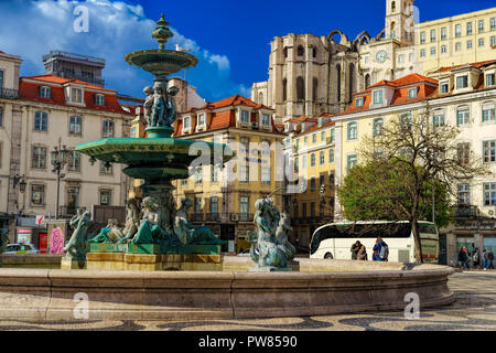 LISBON , PORTUGAL , April 29- 2018. Beautiful view on the fountain on the Rossio square with column during the sunny day . Lisbon . Portugal - Stock Photo