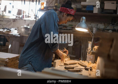 Craftsman woman works in a wood workshop. Handmade concept - Stock Photo