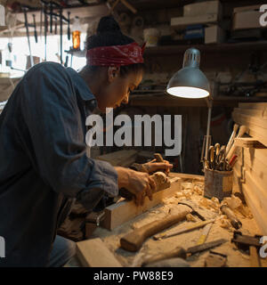 Handmade concept. Craftsman works in a wood workshop - Stock Photo