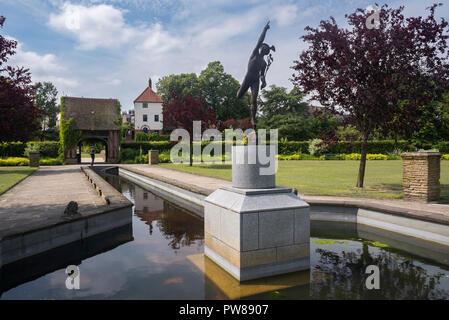 Sunny day view of water feature with statue & lych-gate dovecote, in beautiful peaceful, municipal gardens - Rowntree Memorial Park, York, England, UK - Stock Photo