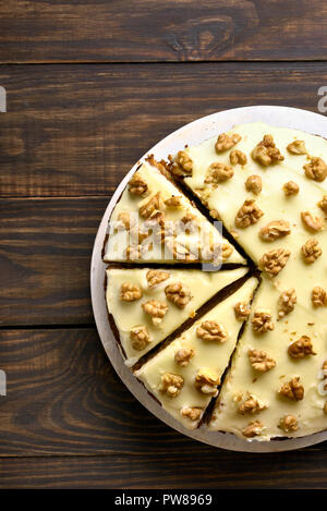 Carrot cake on wooden background. Healthy homemade baking. Top view, flat lay - Stock Photo