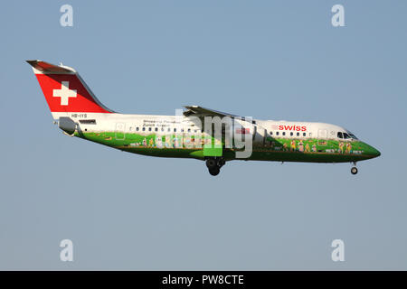 Swiss International Air Lines Avro RJ100 in special Zurich Airport Shopping livery with registration HB-IYS on final for runway 14 of Zurich Airport. - Stock Photo