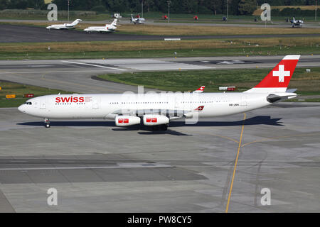 Swiss International Air Lines Airbus A340-300 (old livery) with registration HB-JMK taxiing to runway 34 of Zurich Airport. - Stock Photo