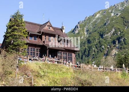 ZAKOPANE, POLAND - OCTOBER 5, 2018. Wooden shelter at Morskie Oko lake near Zakopane in Tatra Mountains. - Stock Photo