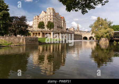 Pulteney Bridge and weir, Grand Parade and riverside vaults all seen with reflections in the River Avon, Bath, England - Stock Photo
