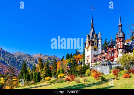Peles Castle, Sinaia, Prahova County, Romania: Famous Neo-Renaissance castle in autumn colours, at the base of the Carpathian Mountains, Europe - Stock Photo