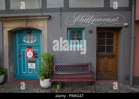 Old half-timbered house front with little ancient historic lifestyle food shops for shipper-men and others in Bremen city. Tourism location Schnoor - Stock Photo